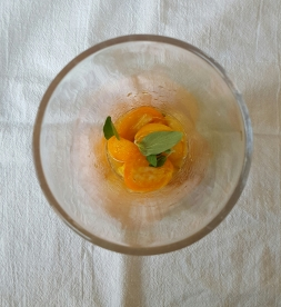 Place 4 halved kumquats, .75 oz simple syrup, and a couple fresh oregano leaves in a mixing glass
